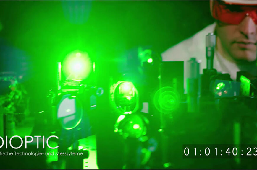 optics setup with green laser and an observer